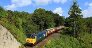 A heritage diesel train travelling on the Bodmin & Wenford Railway