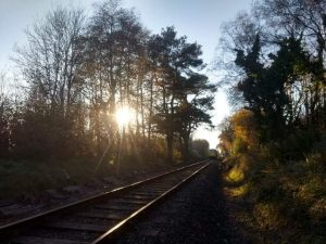 The sun over the train tracks on the Bodmin & Wenford Railway